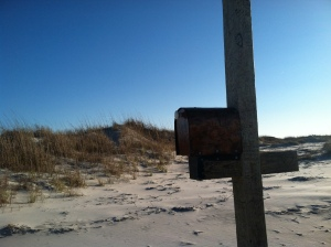 Kindred Spirit mailbox on Wrightsville Beach is silhouetted against the dunes.