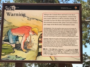 Graphic signs warn of the dangers of hiking in the Grand Canyon.